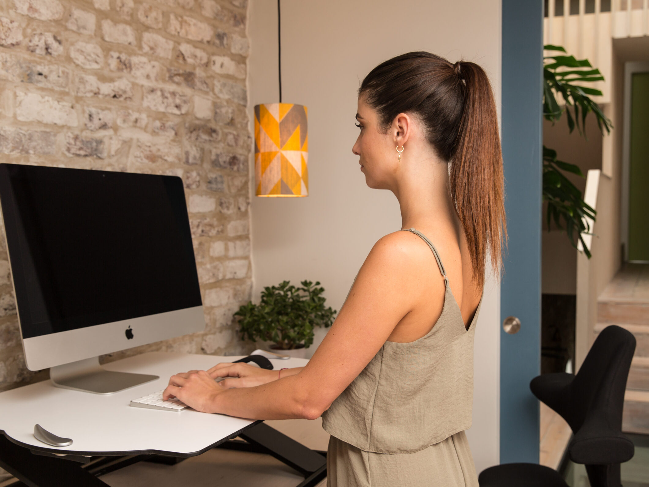 http://woman%20at%20stand%20up%20desk
